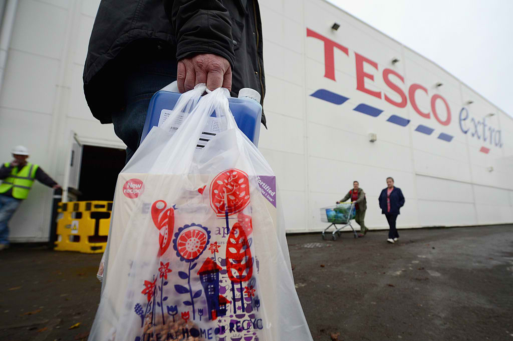 Tesco to settle accounting error for £129 million plus £85 million damages to investors