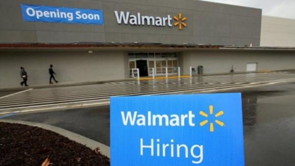 Job postings are shown outside a new Walmart Super Center as the company opens its first store in Compton, California, U.S.